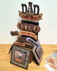 """""""Dad You're Amazing"""" Card-in-a-Box (Note to self: card/box made from a collection called """"Mr Smith's Workshop"""" [UK/Creativity Magazine/docrafts.com - """"not for USA""""]) (Site: photo + instructions for constructing card/box + purchase information for collection)"""
