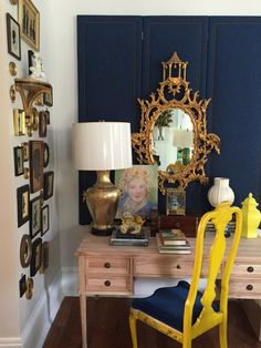 """{The Family Room by Lance Jackson and David Ecton of Parker Kennedy Living incorporates a palette of blue, white, and pops of yellow in their signature """"Southern Regency"""" style.}"""