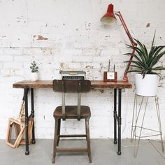 Make a bold statement with this console table or writing desk made from reclaimed wood, salvaged from an old factory in Missouri. The