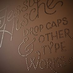 typography done with thumbtacks.