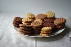 Emma of PaC on her family recipe Biscuits (cookies) - Emma Biscuits. I've tried to make them for this blog several times but never got the photographs right - and I usually only make one flavour. This time I went a bit mental and did all three variations I use. There's the dark brooding cocoa one, the mellow and unusual hot chocolate one, and then the plain - but still quite stunning in its simplicity - vanilla. ~ Just <3 her descriptions ... broody, mellow & stunning simplicity mmm