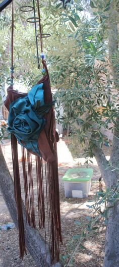 showdiva designs Asymmetrical Larger Leather Medicine Bag Purse LoNg FriNgE N Beads n Hand Sculpted Flower. $250.00, via Etsy.