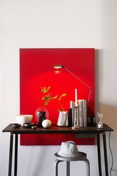 Frame a table with a pop of color...I'd choose a table with a bit more personality,  but I like the concept...