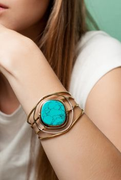 Gold cuff with turquoise stone