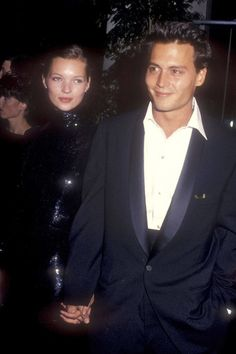 The couple looks dapper as they attend the 52nd Annual Golden Globe Awards in January 1995.