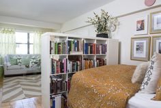 Decorating small spaces - The Washington Post wapo.st/WGlzpf  I like the use of the low bookcases which have the dual function of separating the sleeping space from the living room while providing storage. I would probably add a sheer curtain, mounted from a ceiling track to provide further privacy for the sleeping area.