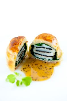 Sea scallops in black tie – a combination of scallops, black truffles, spinach and puff pastry – was made famous at Le Cirque and is still, to this day, one of the most popular items on their menu.