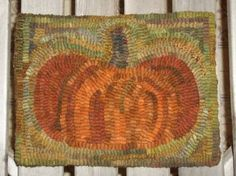 Kelley's gorgeous pumpkin mat.  I love the way she hooked the pumpkin and the way she used scraps with a lot of variety in the background.  Looks like a painting.