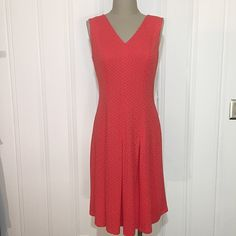 """Redish Orange Textured Dress-NWT-Make Offer Nine West Redish Orange Textured Short Sleeve Dress...New with Tags. Beautiful light weight dress that's perfect for any occasion. Stretchy with back zipper. Outer is made of 95% polyester & 5% elastane. Lining is 100% polyester. Dry clean. Measures 39"""" in length, 19"""" across bust line and 16.5"""" across waist. No trades/No PayPal. Feel free to make an offer...all reasonable offers accepted. MSRP is $89. Nine West Dresses"""