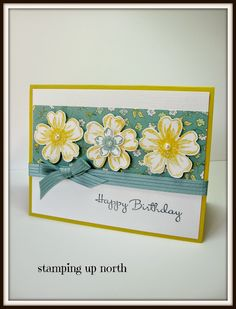 handmade birthday card from stamping up north ... trio of thre layered flowers on a chintz print paper ... lovely bow of stitched satin ribbon ... luv it! ... Stampin'Up!