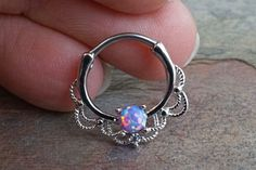 16 gauge purple opal daith hoop ring, daith clicker, or septum hoop. A purple opal centered around a lacey hoop is made of surgical steel set with the purple opal being Can also be u Daith Piercing Schmuck, Innenohr Piercing, Cool Piercings, Septum Jewelry, Cartilage Earrings, Body Jewelry, Stud Earrings, Septum Piercings, Gauges
