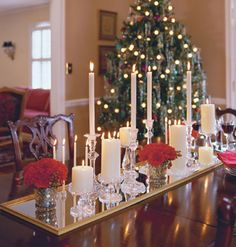 Christmas tablescape using candles, flowers, and a mirror...pretty