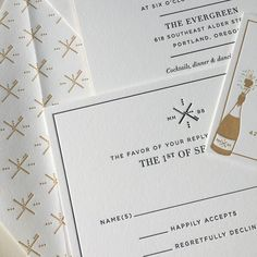 Black and Gold letterpress invitation for a wedding in Portland. The custom envelope liner is based on the PDX airport carpet - a pretty unique choice!