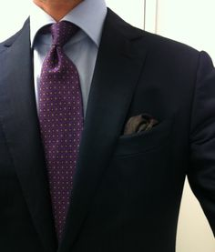 Navy suit, purple tie, light blue shirt