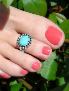 Turquoise toe ring and coral nails