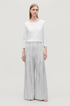 Click to view more detailed imagery on our partner's website Cos Trousers, Printed Trousers, Small Wardrobe, White Shirts, Women Wear, Man Shop, Legs, Clothes For Women, Model