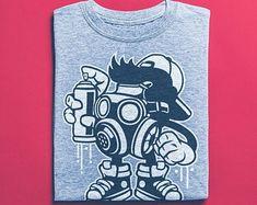 View Surf Shirts by BuyVintageShirts on Etsy Skater Shirts, T Shirts, Surf Shirt, African Safari, Unisex, Vintage Shirts, Tshirts Online, Street Art, Graffiti