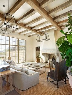 This fireplace looks so grand used with the beams on the ceiling. These light fixtures are great as well!
