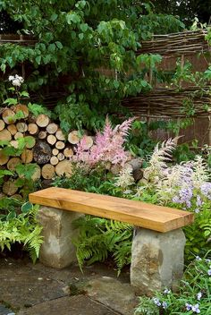 The garden bench - meeting point for romance and relaxation - Arch .- small wooden bench garden with stone foundation Outdoor Garden Bench, Wooden Garden Benches, Garden Planters, Outdoor Gardens, Pot Jardin, Lawn And Landscape, Backyard Garden Design, Mosaic Garden, Garden Statues
