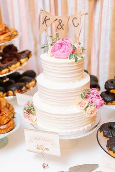 wedding cake with burlap bunting topper, photo by When He Found Her http://ruffledblog.com/brooklands-farm-wedding #weddingcake #cakes