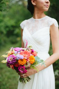 purple and coral bouquet, photo by Brooke Courtney Photography http://ruffledblog.com/shenandoah-valley-wedding #weddingbouquet #flowers