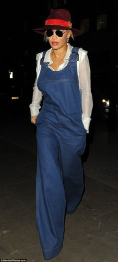 Keeping a low profile: Singer Rita Ora covered up in 70s style dungarees and a burgundy fedora as she arrived at the BBC Radio 1 studios in London first thing on Monday morning