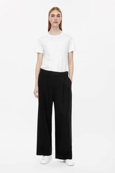 Cos 69 Euros These wide-leg trousers are made from a fluid material with a  comfortable stretch finish. Designed to sit between the hip and waist 25799a483c920