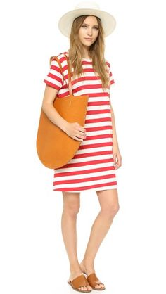 A relaxed Edith A. Miller T-shirt dress, detailed with bold stripes. Banded neckline. Short sleeves. Unlined.