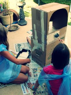 Two cardboard boxes from the garage became the framework for our home-made puppet theater.