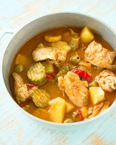 Puerto Rican Chicken (guisado de pollo) is stewed in a sofrito-based broth along with potatoes and olives for incredible flavor!