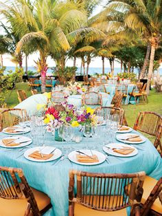 Tropical wedding. Colors are awesome. Love the wooden chairs!