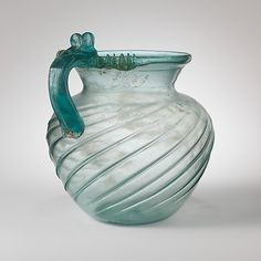 Translucent Blue Green Glass Jug Late First or Second Century AD Early to Mid Imperial Source: The Metropolitan Museum of Art Glass Jug, Glass Bottles, Perfume Bottles, History Of Glass, Art Romain, Roman Art, Antique Glass, Antique Bottles, Vintage Bottles