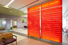 Partition wall shown with ViviGraphix Spectra glass in View configuration with custom graphic interlayer and Pearlex finish at University Health System - Robert B. Green Campus, San Antonio, Texas