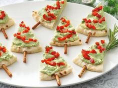 Serve guacamole the festive way with pita bread and pretzel sticks. | 38 Clever Christmas Hacks That Will Make Your Life Easier