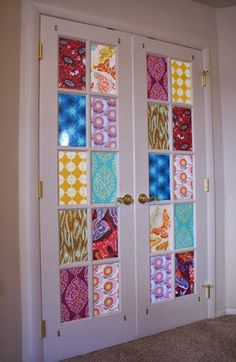 Cover French door windows with fabric for a stained glass effect...love it!