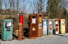 Antique gas pumps resemble the king, queen, and pawns   in a chess game - Forest VA
