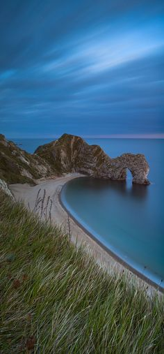 Durdle Door is a natural limestone arch on the Jurassic Coast near Lulworth in Dorset, England