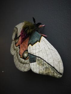 This moth is about 5 inches tall and 10 1/2 inches wide. The wings are made from fabric which is hand painted and embroidered with layer of thread creating texture and…