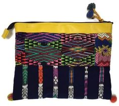 These one-of-a-kind, eco-friendly iPad Case/Clutches are up-cycled from traditional shirts (huipil) and skirts (corte) worn by Mayan women in Guatemala. They are all one of a kind just like you!  They