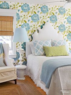 In a stroke of boldness, a large-scale wallpaper isn't the only statement-maker. A sculptural headboard is eye-catching, but the white fabric provides a visual break from the pattern action. What we love: Using a pattern to determine a color scheme. The blues and greens of the bold floral wallpaper play out in the bedding and accessories.