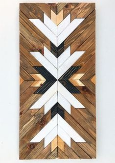 This piece is made to order. Lead time for shipping is 2 to 3 weeks. The photo shown is a previously sold beautiful modern art piece made with reclaimed wood. Its made with pallet and reclaimed wood It can be hanged vertically or horizontally. We used 2 different wood stains and