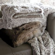 My bedding is made of white, black & grey's... this grey fur blanket is definitely on top of my wishlist