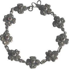 Vintage Sterling Silver, Marcasite and Garnet Daisy Chain Link Bracelet. A delicate beauty with small bezel set garnets surrounded by sparkling marcasite at whimsicalvintage.rubylane.com Please visit my sale section for savings of 20% to 50% off of vintage jewelry, porcelain, pottery and glass. from WhimsicalVintage on Ruby Lane!