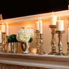 A collections of silver candlesticks