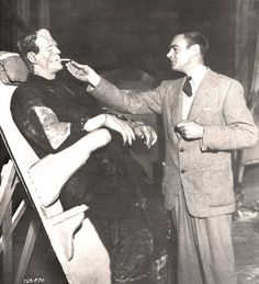 Frankenstein and his monster.... Many costumes in the days of the Silver Screen were impossible to sit in without damaging. The studios had boards like these, which could be leaned back, for the actors to use between shoots. Karloff's costume weighed almost as much as he did.