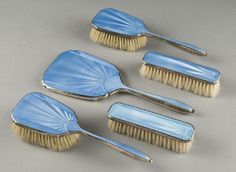 Lot: 381: 5 Pc. Art Deco blue enamel and silver vanity set, Lot Number: 0381, Starting Bid: $250, Auctioneer: Dallas Auction Gallery, Auction: Antiques and Fine Art, Date: September 2nd, 2009 CEST