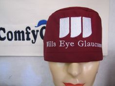 Wills Eye Glaucoma clinic logo embroidered on a crimson male scrub cap.