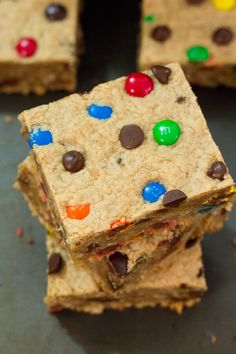Super soft & chewy Monster Cookie Bars. Filled with peanut butter, oatmeal, chocolate chips and M&Ms - you'll be thankful this recipe makes an extra large batch!