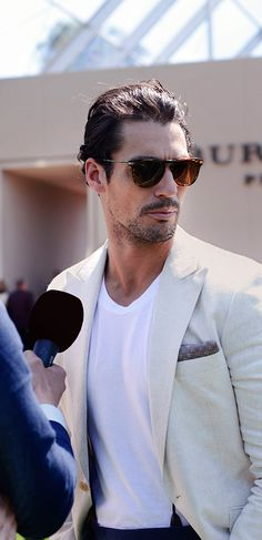 David Gandy talking to press outside before the Burberry show begins