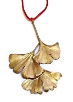Michael Michaud - Table Art - Gingko Leaf Ornament Shown here is the Gingko Leaf Ornament rendered in pewter with a gold over copper finish. Measures 5 inches in length by 3 3/4 inches wide and comes